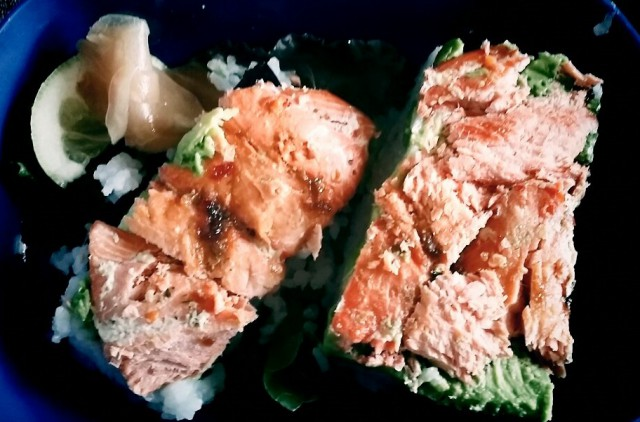 roasted salmon on rice with avocado and seaweed