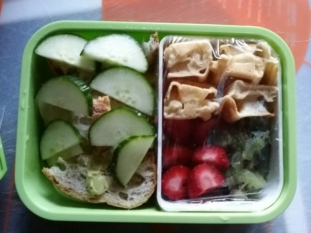 full lunch for D.- turkey and awiss cheese with avocado and cucumbers+ bread kiwi and strawberry mix plus waffles for desert