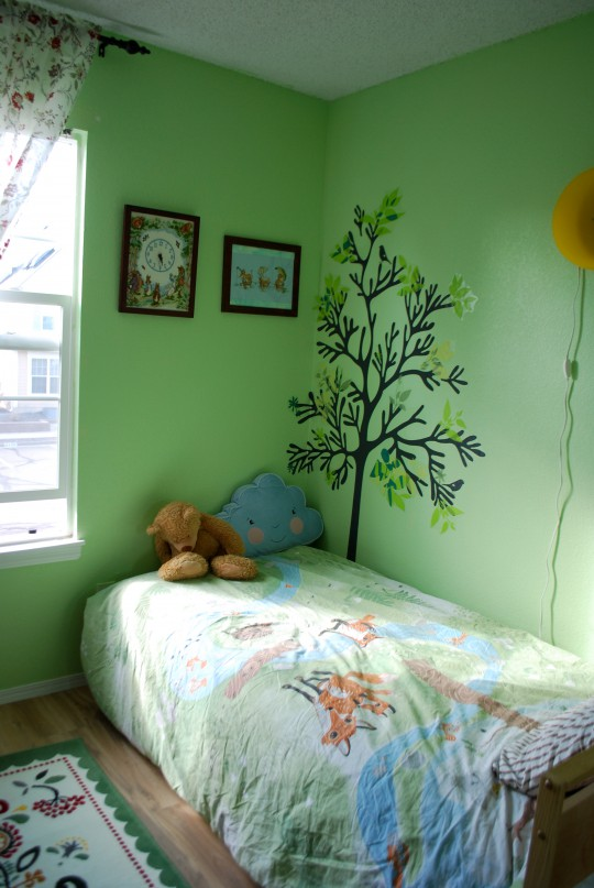 Behr Spring Glow paint. IKEA wall stickers (trees and leaves are separate sets), cross stitch by me, IKEA bed linen, IKEA rug